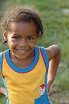 Smiling girl in Barranco, a Garifuna Village, southern Belize..
