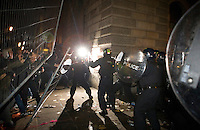 Police clash with protestors outside the Treasury building during a student demonstration in Westminster, central London on the day the government passed a bill to increase university tuition fees.