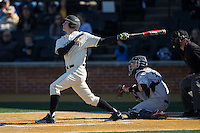 Kevin Conway (7) of the Wake Forest Demon Deacons follows through on his swing against the Richmond Spiders at David F. Couch Ballpark on March 6, 2016 in Winston-Salem, North Carolina.  The Demon Deacons defeated the Spiders 17-4.  (Brian Westerholt/Four Seam Images)