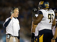 California defensive tackles coach Barry Sacks talks with Deandre Coleman of California during the game at Rose Bowl in Pasadena, California on October 12th, 2013.   UCLA defeated California, 37-10.