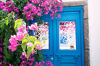 Flowers and a doorway in the town of Megalochori in Santorini, Greece on July 7, 2013.