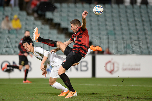 21.04.2015. Sydney, Australia. AFC Champions League. Western Sydney Wanderers versus Kashima Antlers. Wanderers defender Matthew Spiranovic  clears the ball from defence. Kashima won 2-1.