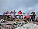 03/11/14<br /> <br /> Walkers pay their respects near  wreckage at a crash site where thirteen airmen were killed when their bomber hit remote moorland high up in the Peak District 66 years ago today.<br /> <br /> Amazingly, the area on Bleaklow Moor is so remote that many of the aircraft's twisted remains, including at least two of engines from the B29 Superfortress still litter the site today.<br /> <br /> The American bomber, known as 'Over-Exposed!' had been converted into a photo reconnaissance aircraft.<br /> <br /> In some of its earlier flights it had been used to photograph the nuclear bomb tests at Bikini Atoll in the Pacific Ocean and had also taken part in the Berlin airlift.<br /> Captain Landon P. Tanner took off on the morning of 3rd November 1948, at around 10.15 from Scampton, Lincolnshire heading on a routine flight to Burtonwood USAF base in Warrington. The B29 was carrying USAF wages among other things. The crew were due to return to the States in a few days.<br /> When 'Over Exposed!' failed to arrive at Burtonwood an air search was initiated, and that afternoon blazing wreckage was spotted high on the moors near Higher Shelf Stones. By chance members of the Harpur Hill RAF Mountain Rescue Unit were just finishing an exercise two and a half miles away, so they quickly made their way to the scene of the crash but there was clearly nothing that could have been done for any of the crew.<br /> This is just one of 180 military and civilian aircraft that have crashed in and around the Peak District since 1918.<br /> <br /> All Rights Reserved - F Stop Press.  www.fstoppress.com. Tel: +44 (0)1335 300098