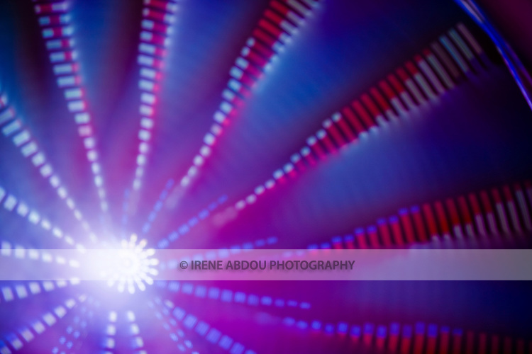 """A photography technique called """"focus blur"""" combined with a long exposure is used to transform the lights of the ferris wheel into abstract designs at the Montgomery County Agricultural Fair in Gaithersburg, Maryland."""