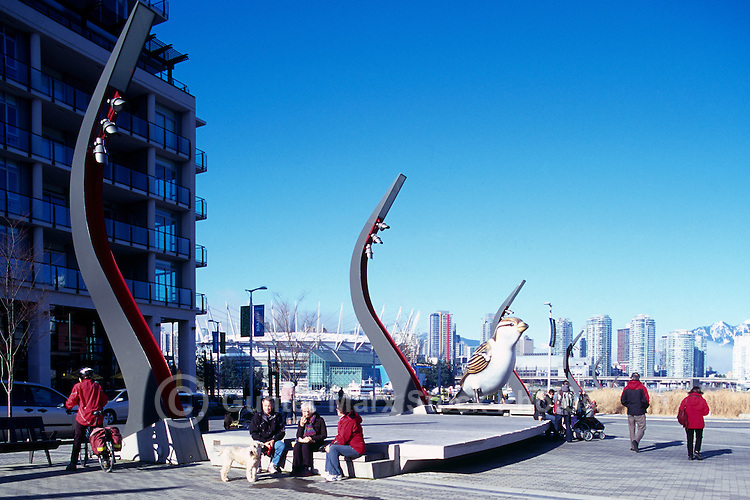 Olympic Plaza at the Village on False Creek (aka Olympic Village), Vancouver, BC, British Columbia, Canada - Giant Sparrow Sculpture (artist - Myfanwy MacLeod), City of Vancouver Skyline, and BC Place Stadium (New Retractable Roof completed in 2011) in Background