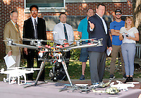 NWA Democrat-Gazette/DAVID GOTTSCHALK  Mark Rushing (third from right), director of strategic communications with the University of Arkansas, discusses the prohibition of Unmanned Aircraft Systems, commonly referred to as unmanned aerial vehicles or drones, on University property Monday, August 31, 2015 on the terrace of Janelle Y. Hembree Aumni House on the campus in Fayetteville.
