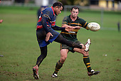 A. Luteru kicks over K. Farrell. Counties Manukau Premier Club Rugby, Pukekohe v Ardmore Marist played at the Colin Lawrie field, on the 27th of May 2006.Ardmore Marist won 22 - 6
