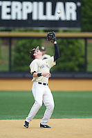 Wake Forest Demon Deacons shortstop Conor Keniry (14) settles under a pop fly during the game against the Virginia Cavaliers at Wake Forest Baseball Park on May 17, 2014 in Winston-Salem, North Carolina.  The Demon Deacons defeated the Cavaliers 4-3.  (Brian Westerholt/Four Seam Images)