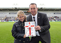 PICTURE BY VAUGHN RIDLEY/SWPIX.COM - Rugby League - 2013 International Origin - England v Exiles - Halliwell Jones Stadium, Warrington, England - 14/06/13 - England's Head Coach Steve McNamara with the young girl who designed the cover of the match programme.