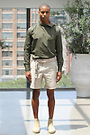 Model Malik poses in an outfit from the Deveaux Spring Summer 2017 collection on July 13 2016, during New York Fashion Week Men's Spring Summer 2017.