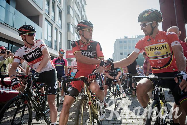 Race leader Rohan Dennis (AUS/BMC) witnesses Olympic Champion Greg Van Avermaet (BEL/BMC) shaking hands on the start line with World & (freshly) European Champion Peter Sagan (SVK/Tinkoff)<br /> <br /> <br /> 12th Eneco Tour 2016 (UCI World Tour)<br /> stage 3: Blankenberge-Ardooie (182km)