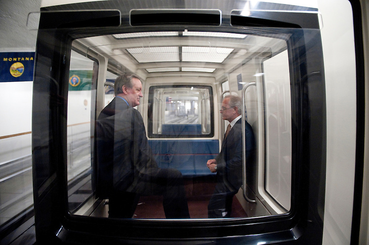 UNITED STATES - JUNE 22: Sen. Bob Corker, R-Tenn., right, and Sen. Mike Crapo, R-Idaho, talk on the Senate subway as they head back to their offices after a Senate Republican caucus meeting in the Capitol on Wednesday, June 22, 2011. (Photo By Bill Clark/Roll Call)