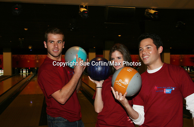 Scott Evans, Brittany Underwood, Jason Tam bowl at the 2009 Daytime Stars and Strikes to benefit the American Cancer Society to benefit the American Cancer Society on October 11, 2009 at the Port Authority Leisure Lanes, New York City, New York. (Photo by Sue Coflin/Max Photos)
