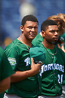 Daytona Tortugas pitcher Keury Mella (34) and Angelo Gumbs (21) during the national anthem before a game against the Clearwater Threshers on April 20, 2016 at Bright House Field in Clearwater, Florida.  Clearwater defeated Daytona 4-2.  (Mike Janes/Four Seam Images)