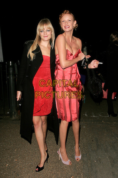 ALEXIA INGE & OLIVIA INGE.Vivienne Westwood Opus - launch party, The Serpentine Gallery, London, England. .February 12th, 2008.full length pink strapless dress black bag purse cleavage smoking cigarette coat sisters siblings family .CAP/AH.©Adam Houghton/Capital Pictures.