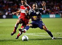 New York midfielder Juan Pietravallo (23) takes the ball away from Chicago Fire midfielder Stephen King (33).  The Chicago Fire defeated the New York Red Bulls 1-0 at Toyota Park in Bridgeview, IL on September 6, 2008.