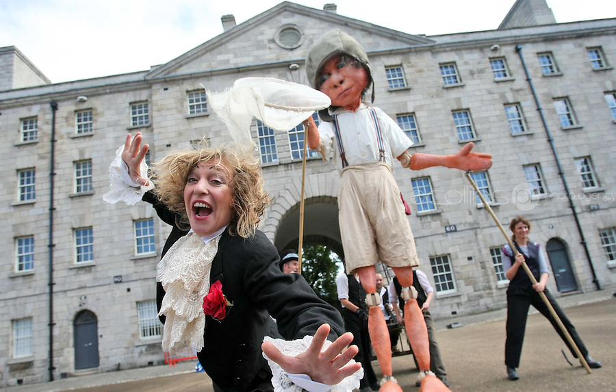 10/09/'10 Machna performer, Debbie Wright pictured with a 15 foot high 8 year old boy explorer puppet at The National Museum of Ireland, Collins Barracks this afternoon as they prepare for the Saturday opening spetacular Absolut Fringe 16th Annual Fringe Festival. The free show opens tomorrow night at Collins Barracks at 8pm and runs until the 26th Sept..Picture Colin Keegan, Collins, Dublin.
