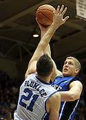 "Junior Mason Plumlee shoots over his older brother, senior Miles Plumlee, for another two points. Duke men's basketball had an opening scrimmage game as a part of the ""Countdown to Craziness"" event at Cameron Indoor Stadium Friday Oct. 14, 2011.  Photo by Al Drago..."