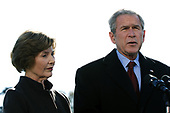 United States President George W. Bush, with First Lady Laura Bush, speaks about the terrorist attacks on Mumbai, India after arriving at the White House from Camp David, in Washington on November 29, 2008. <br /> Credit: Alexis C. Glenn / Pool via CNP