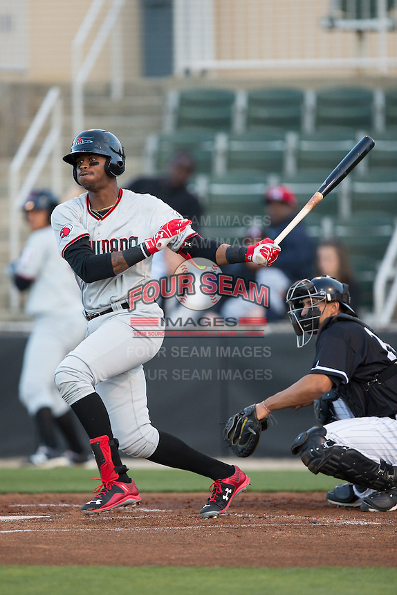 Ti'Quan Forbes (10) of the Hickory Crawdads follows through on his swing against the Kannapolis Intimidators at Kannapolis Intimidators Stadium on April 8, 2016 in Kannapolis, North Carolina.  The Crawdads defeated the Intimidators 8-2.  (Brian Westerholt/Four Seam Images)