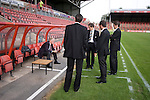 Bangor City 0 FC Honka 1, 23/07/2009. Racecourse Ground, Europa League. The four match officials from Germany chatting to a UEFA representative next to the pitch before Bangor City's Europa League second round second leg tie against FC Honka from Finland at Wrexham's Racecourse Ground. The match had to be staged away from City's Farrar Road ground as it did not meet UEFA's stadium standards. The Finns won 1-0 in Wales to go through 3-0 on aggregate in front of 602 spectators in the first season of the newly-introduced competition which replaced the UEFA Cup. Photo by Colin McPherson.