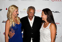 Aug. 29, 2013; Avon, IN, USA: NHRA NHRA funny car driver Courtney Force (left) with Don Prudhomme (center) and Ashley Force Hood on the red carpet prior to the premiere of Snake & Mongoo$e at the Regal Shiloh Crossing Stadium 18. Mandatory Credit: Mark J. Rebilas-