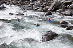 Kayakers in Tumwater Canyon of Wenatchee River.    This rapids is below Falls Creek and above the small reservoir at the Alps candy store. near Leavenworth, Washington.