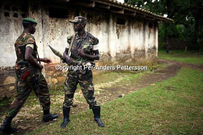 KILOLIRWE, DRC OCTOBER 2: Soldiers loyal to the elusive rebel leader General Laurent Nkunda stand guard outside his compound on October 2, 2006 in Kilolirwe, outside Goma, DRC. General Nkunda has been charged with was crimes and he is one of the few rebel leaders that has not joined the current peace deal and elections in Congo, DRC. He has about 2-4000 soldiers in his army. Nkunda is accused of numerous war crimes and other serious human rights violations the past few years including summary executions, torture, and rape committed under his command. The incidents are a mainly in Bukavu in 2004 and in Kisangani in 2002. Nkunda is a Congolese Tutsi, and he was born in Congo?s North Kivu Province, close to Rwanda. .(Photo by Per-Anders Pettersson/Getty Images)..