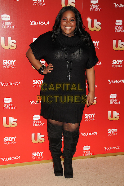 AMBER RILEY .At US Weekly's Hot Hollywood Party 2009 held at Voyeur, West Hollywood, California, USA, .18th November 2009..full length black jumper sweater knitted dress knee high boots hand on hip cross necklace .CAP/ADM/BP.©Byron Purvis/AdMedia/Capital Pictures.
