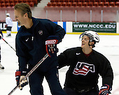 Mark Osiecki (US - Assistant Coach), John Carlson (US - 6) - Team USA practiced on Friday, August 14, 2009, in the 1980/Herb Brooks (international-sized) Rink prior to their third game versus Team Russia during the 2009 USA Hockey National Junior Evaluation Camp in Lake Placid, New York.