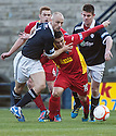 Raith's Simon Mensing gets a grip of Pars' Ryan Wallace ...