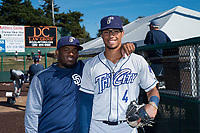 Tri-City Dust Devils teammates Jonathan Guzman (16) and Tre Carter (4) pose for a photo before a Northwest League game against the Everett AquaSox at Everett Memorial Stadium on September 3, 2018 in Everett, Washington. The Everett AquaSox defeated the Tri-City Dust Devils by a score of 8-3. (Zachary Lucy/Four Seam Images)