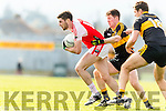 Kieran O'Leary and Eoin Brosnan Dr Crokes in action against Paul Geaney Dingle in the Senior County Football Semi Final in Fitzgerald Stadium on Sunday.