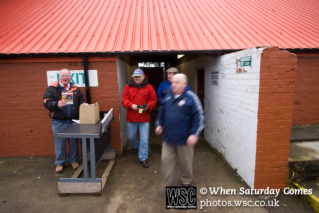 Workington AFC 0 Boston United 1, 24/02/2008. Borough Park, Blue Square North. Fans entering the stadium prior to the Blue Square North fixture between hosts Workington AFC (red) and Boston United at Borough Park. The visitors won with a solitary sixth-minute goal by Jon Rowan in front of 388 spectators. Both Workington AFC and Boston United were members of the Football League, the Cumbrians losing League status in 1977 while the Lincolnshire club were relegated in 2007 and demoted two divisions for financial irregularities. Photo by Colin McPherson.