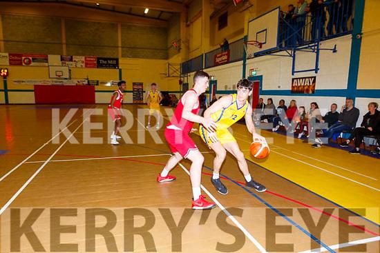 E O'Sullivan Killorglin shields the ball from D Lehane UCC Demons during their game in Killoglin on Sunday