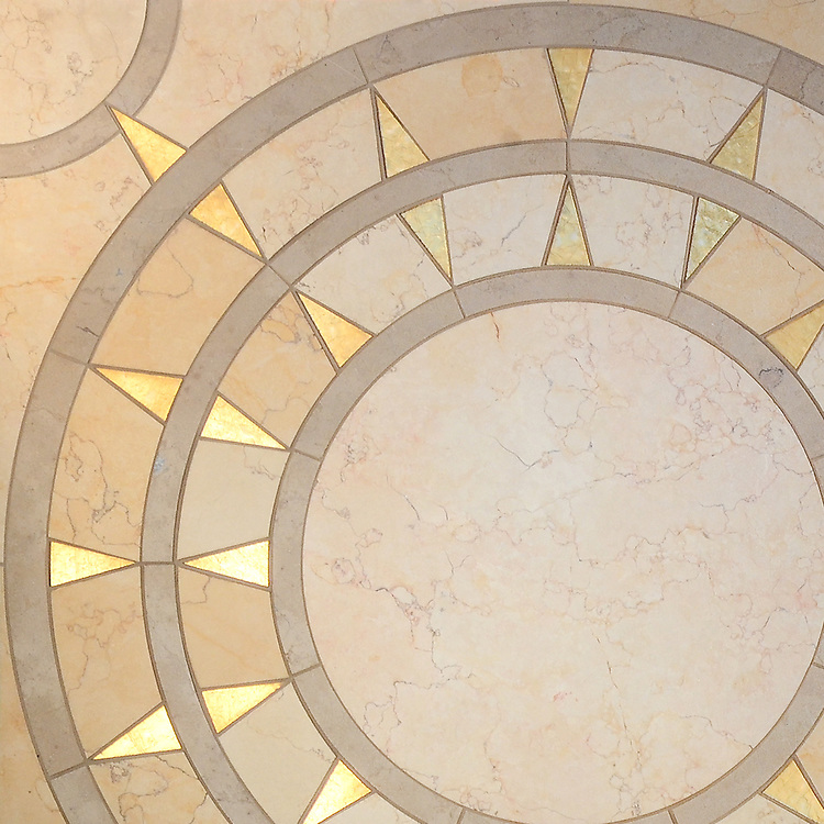 Mireille Grand, a waterjet mosaic shown in Lagos Gold, Sylvia Gold and honed 24K Gold Glass, is part of the Aurora® collection by Sara Baldwin for New Ravenna.