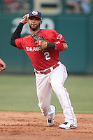 Jonathan Villar (2) of the Oklahoma City RedHawks throws to first base during the Pacific Coast League game against the Round Rock Express at Chickashaw Bricktown Ballpark on June 14, 2013 in Oklahoma City ,Oklahoma.  (William Purnell/Four Seam Images)