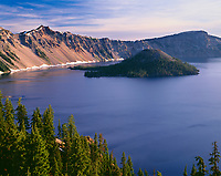 ORCL_064 - USA, Oregon, Crater Lake National Park, West rim of Crater Lake with Hillman Peak (center) and Llao Rock (right) above Wizard Island.