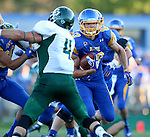 BROOKINGS, SD - SEPTEMBER 6:  Jason Schneider #83 from South Dakota State University looks for running room past Cameron Ontko #4 from Cal Poly in the first half of their game Saturday evening at Coughlin Alumni Stadium in Brookings.(Photo/Dave Eggen/Inertia)