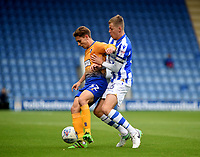Mansfield Town's Danny Rose battles with Colchester United's Frankie Kent<br /> <br /> Photographer Hannah Fountain/CameraSport<br /> <br /> The EFL Sky Bet League Two - Colchester United v Mansfield Town - Saturday 7th October 2017 - Colchester Community Stadium - Colchester<br /> <br /> World Copyright &copy; 2017 CameraSport. All rights reserved. 43 Linden Ave. Countesthorpe. Leicester. England. LE8 5PG - Tel: +44 (0) 116 277 4147 - admin@camerasport.com - www.camerasport.com