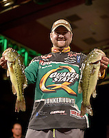 NWA Democrat-Gazette/BEN GOFF -- 04/25/15 Matt Arey, FLW pro from Shelby, N.C., displays his two best bass during weigh-in on day three of the Walmart FLW Tour at Beaver Lake on Saturday Apr. 25, 2015 at the John Q. Hammons Center in Rogers. Arey, last year's Beaver Lake champion, stood in second place with a three-day total of 37 lbs. 9 oz.