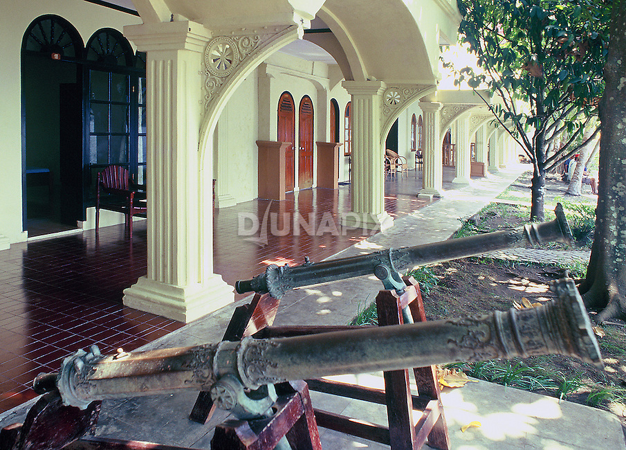 Dutch colonial canons decorate the hotel owned by Des Alwi, Banda Neira, Maluku, Indonesia
