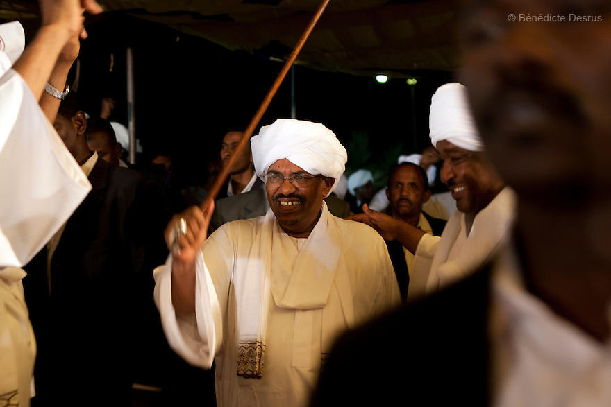 26 april 2010 - NCP party's Khartoum headquarters, Karthoum, Sudan - Sudan's president Omar al-Bashir celebrates his victory at the NCP party's Khartoum headquarters. He won another term in office, according to election officials, with a comfortable majority in elections marred by boycotts and fraud allegations, becoming the first leader to be elected while facing an international arrest warrant for alleged crimes he orchestrated in the western region of Darfur. The elections take place as Sudan heads toward a referendum in eight months that could lead South Sudan to split off and become Africa's newest nation. Photo credit: Benedicte Desrus