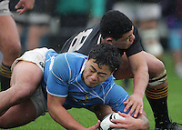 Haize Aalatipi beats Wellington College number eight Luke Tau'alupe to loose ball during the Wellington Secondary Schools premier rugby final between Silverstream and Wellington College at Hutt Recreation Ground, Petone, Wellington, New Zealand on Sunday, 12 August 2012. Photo: Dave Lintott / lintottphoto.co.nz