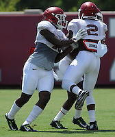 NWA Democrat-Gazette/ANDY SHUPE<br /> Arkansas defensive back Ryan Pulley (left) participates in a drill Saturday, Aug. 8, 2015. during practice at the university football practice field in Fayetteville.