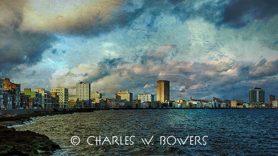 Sunrise over the Malecon with heavy clouds<br />