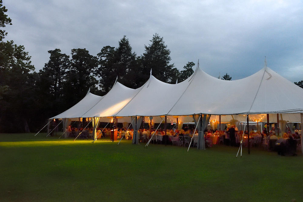 Outside view of the tent at dusk at a summer gala.