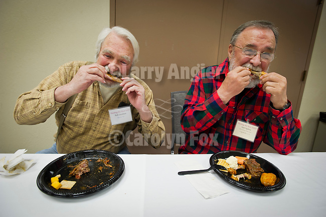 Bob Goodman and Sam Hipkins enjoy chicken and ribs during Shooting the West XXIV, WInnemucca, Nevada