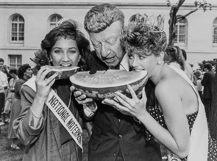 Renee Thomas, Warner Robins, Georgia, National Watermelon Queen, Sen. William V. Roth, R-Del., and April Meilhammer, Delmar, Maryland, Queen representative Delmar and Maryland eating watermelon together on Aug. 7, 1988. (Photo by Andrea Mohin/CQ Roll Call)