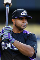 Wilin Rosario #20 of the Colorado Rockies before a game against the Los Angeles Dodgers at Dodger Stadium on April 30, 2013 in Los Angeles, California. (Larry Goren/Four Seam Images)